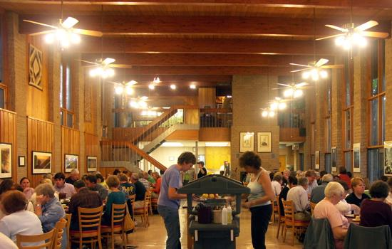 Workshop attendees eat in the dining hall.